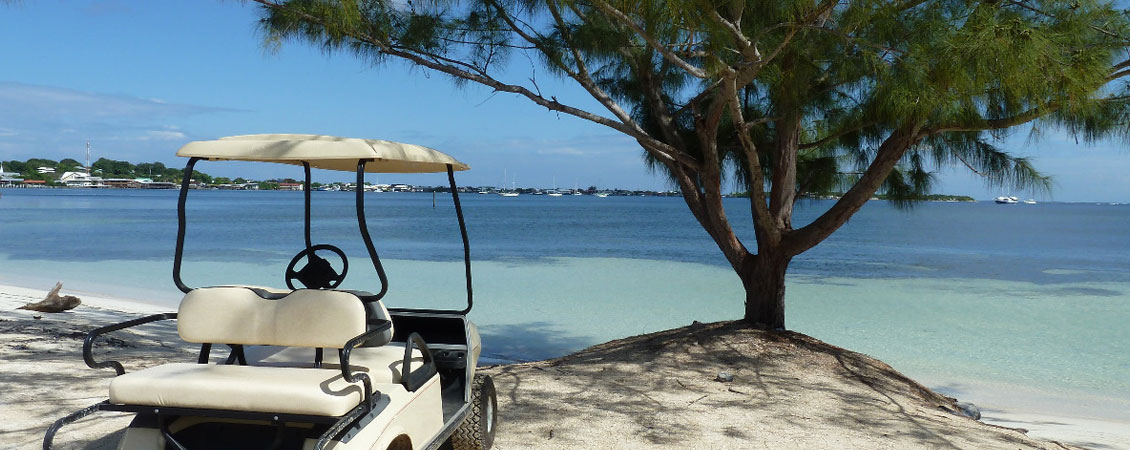 banner_karibik_honduras_utila_strand_golfcart